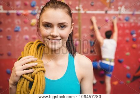 Fit woman at the rock climbing wall at the gym