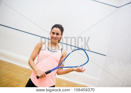 Woman eager to play squash in the squash court