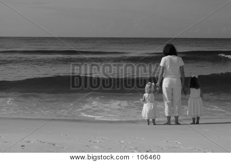 Mom And Daughters On The Beach