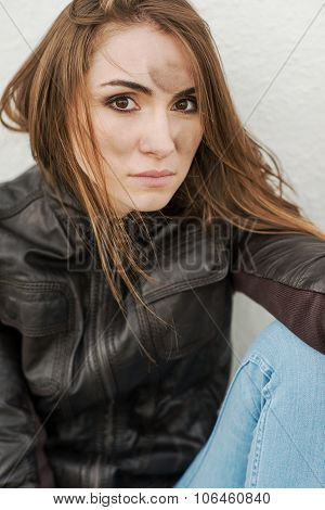 Evil girl with long hair in leather jacket