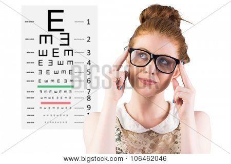 Hipster redhead looking up thinking against eye test
