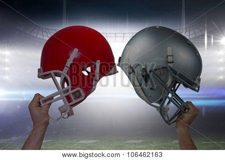 American football player handing his helmet against american football arena