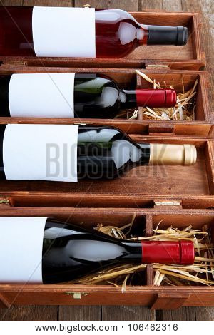 Wine bottles in wooden cases, close up.