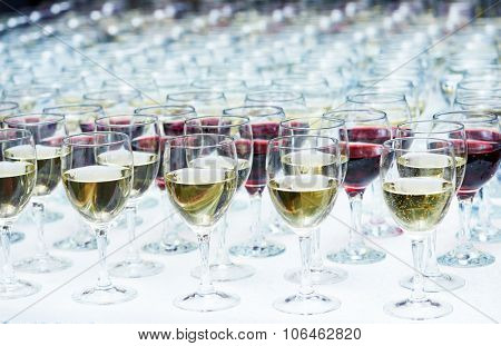 catering services. rows of glasses with wine at restaurant party or celebration