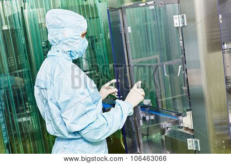 pharmaceutical factory woman worker in front of production line at pharmacy industry manufacture factory