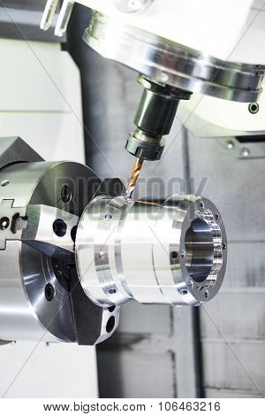 metalworking industry. drilling a hole on modern metal working machining center