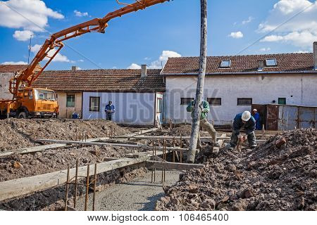 Team Of Construction Workers Are Working On Concreting At Construction Site.