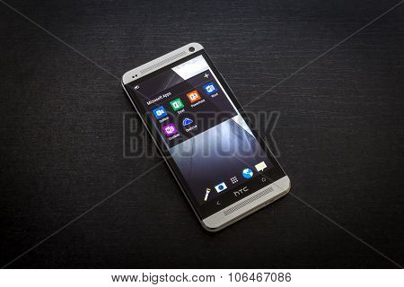Microsoft apps icons on screen of a mobile smartphone.