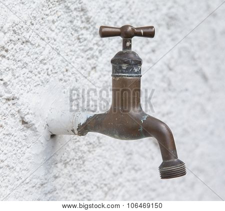 Old Water Tap On A White Wall