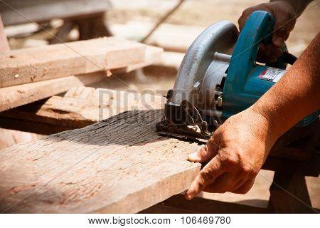 Electric Saw Cutting Wood