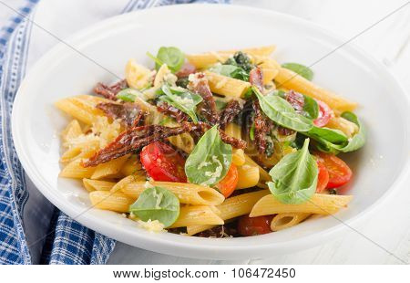 Pasta With Sun Dried Tomato On A White Plate.