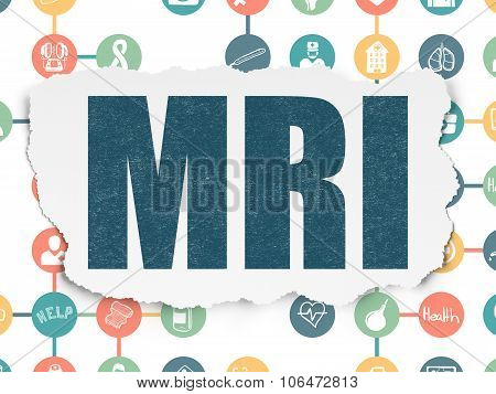 Healthcare concept: MRI on Torn Paper background