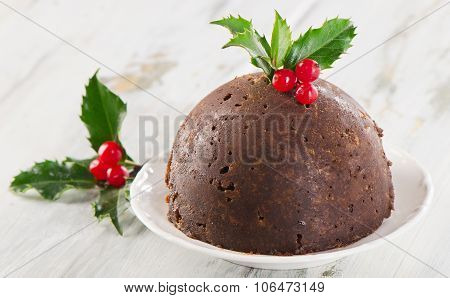 Christmas Pudding With Holly On Plate.