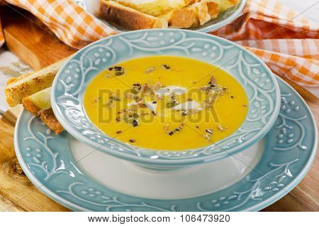 Bowl Of Pumpkin Soup With Bread Crouton.