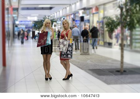 Two Blond Shopping Woman