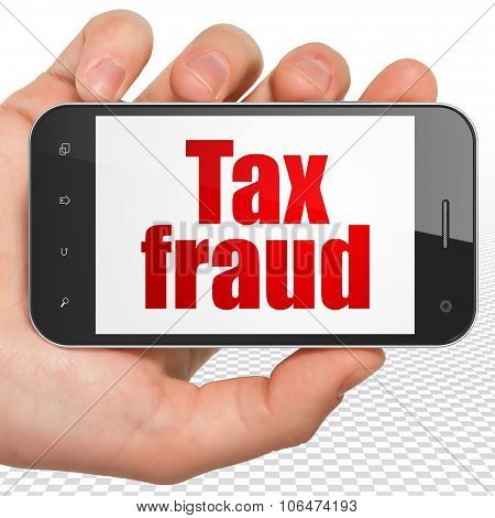 Law concept: Hand Holding Smartphone with Tax Fraud on display