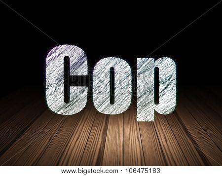 Law concept: Cop in grunge dark room