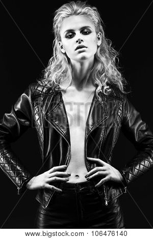 Daring Girl Model In Black Leather Dress, Style Of Rock, Dark Makeup And Wet Hair.  Bl