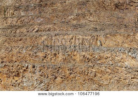 Limestone Quarry Vertical Wall. Rocky Substrate By Levels