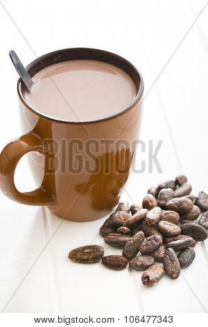 the cocoa drink and cocoa beans on kitchen table
