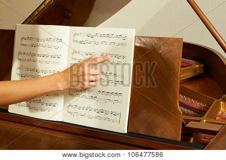 Woman's Teaching The Piano Closeup