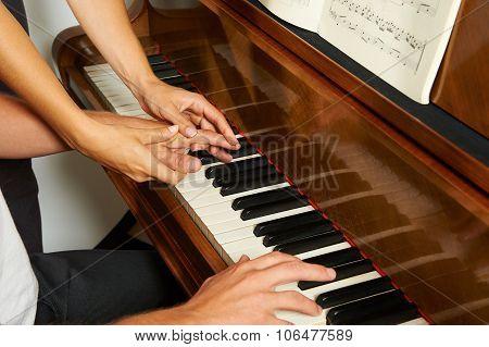 Woman's Teaching The Piano Closeup
