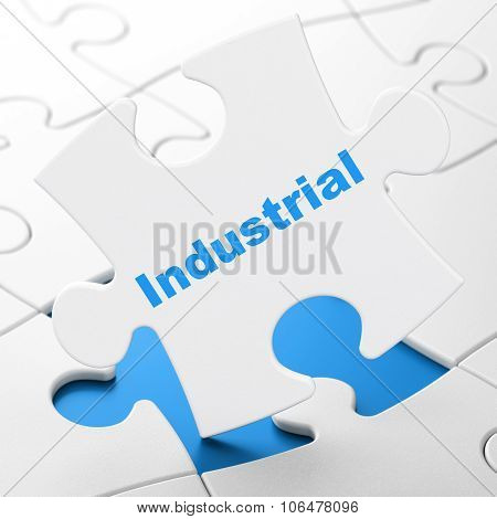 Manufacuring concept: Industrial on puzzle background