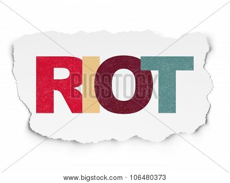 Political concept: Riot on Torn Paper background