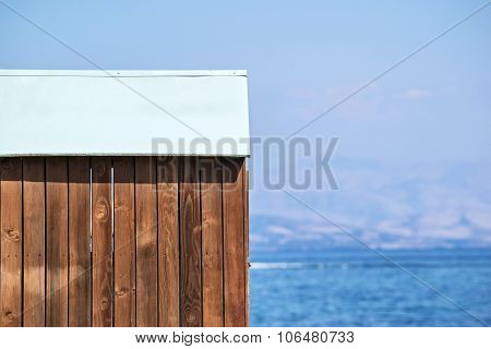 Wooden Shed Against Sea And Sky