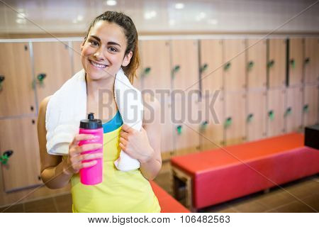 Smiling woman ready for a workout in the gym locker room