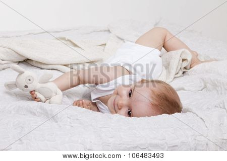 Playful Toddler Girl In Bed