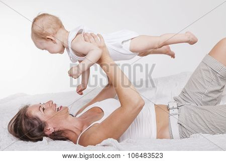 Mother And Baby Playing Together