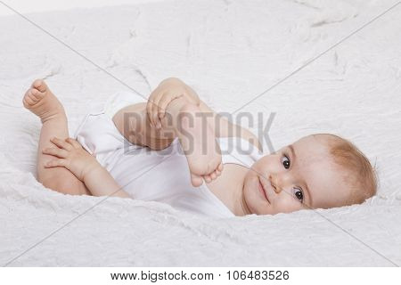 Playful Baby Girl In Bed