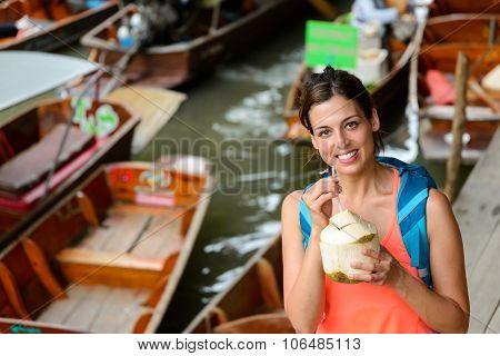 Woman On Travel To Thailand At Damnoen Saduak Floating Market