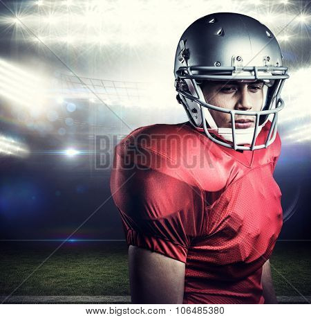 Close-up of confident American football player against american football arena