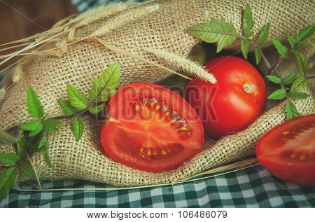 Ripe red tomatoes on a background of burlap.