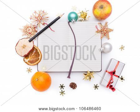 A Notebook With A Pencil And Christman Decoration Around It