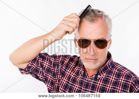 Gray Aged Man With Sunglasses Combing His  Hair