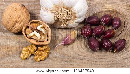 Dried Fruit Of Hawthorn, Garlic And Walnuts. The Concept Of Alternative Medicine.