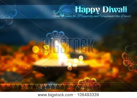 illustration of decorated Diwali diya on flower rangoli