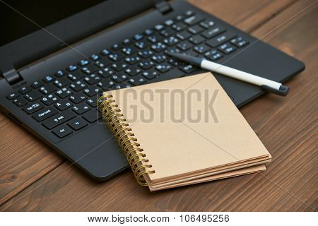 Laptop Computer And Memo Note With Ballpoint Pen