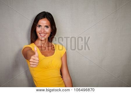 Good-looking Woman Congratulating With Thumb Up