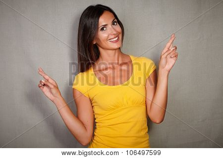 Charismatic Female Crossing Fingers While Wishing
