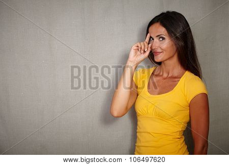 Pensive Woman Remembering With Finger Raised