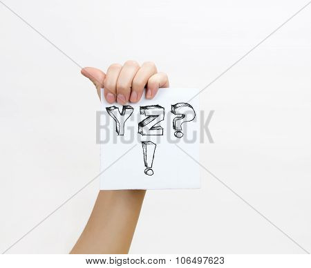 Hand Holding A Piece Of Paper With Sketchy Capital Letters Y Z ? !, Isolated On White.