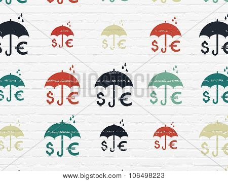 Protection concept: Money And Umbrella icons on wall background