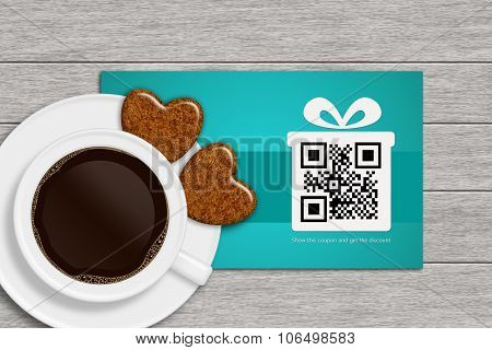 Christmas Discount Coupons With Qr Code And Coffee On Wooden Desk