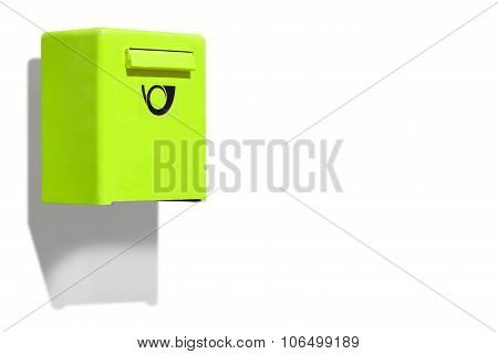 Green letterbox on white wall
