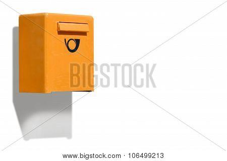 Orange letterbox on white wall