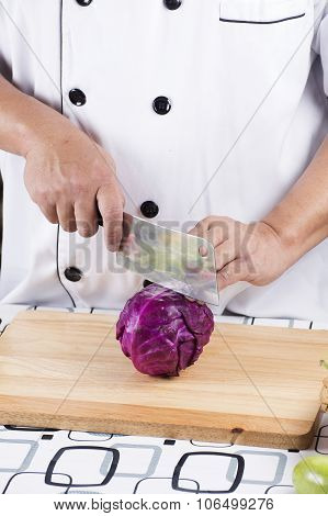 Chef Cutting Purple Cabbage